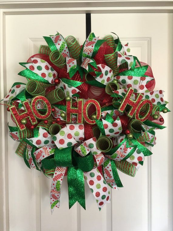 Deco Mesh Christmas Wreath, Christmas Wreath, Ho Ho Ho Wreath, Christmas Wreath For Front Door, Front Door Christmas Decor, Christmas Wreath  Deco Mesh Christmas Wreath in the colors of red, green, lime green and white with Ho Ho Ho accent. This Ho Ho Ho Wreath will be the perfect addition to your Christmas Decorations. This wreath is very full and has a lot of texture and dimension with two styles of mesh, three different styles of ribbons and glittered ornaments thoughtfully placed…