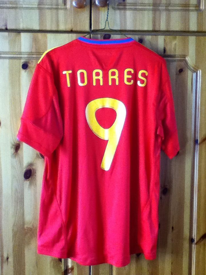 7b6c702fce7 Spain National Football Team Home Jersey for the 2010 World Cup. The Shirt  has the name Torres on the back along with the number 9.