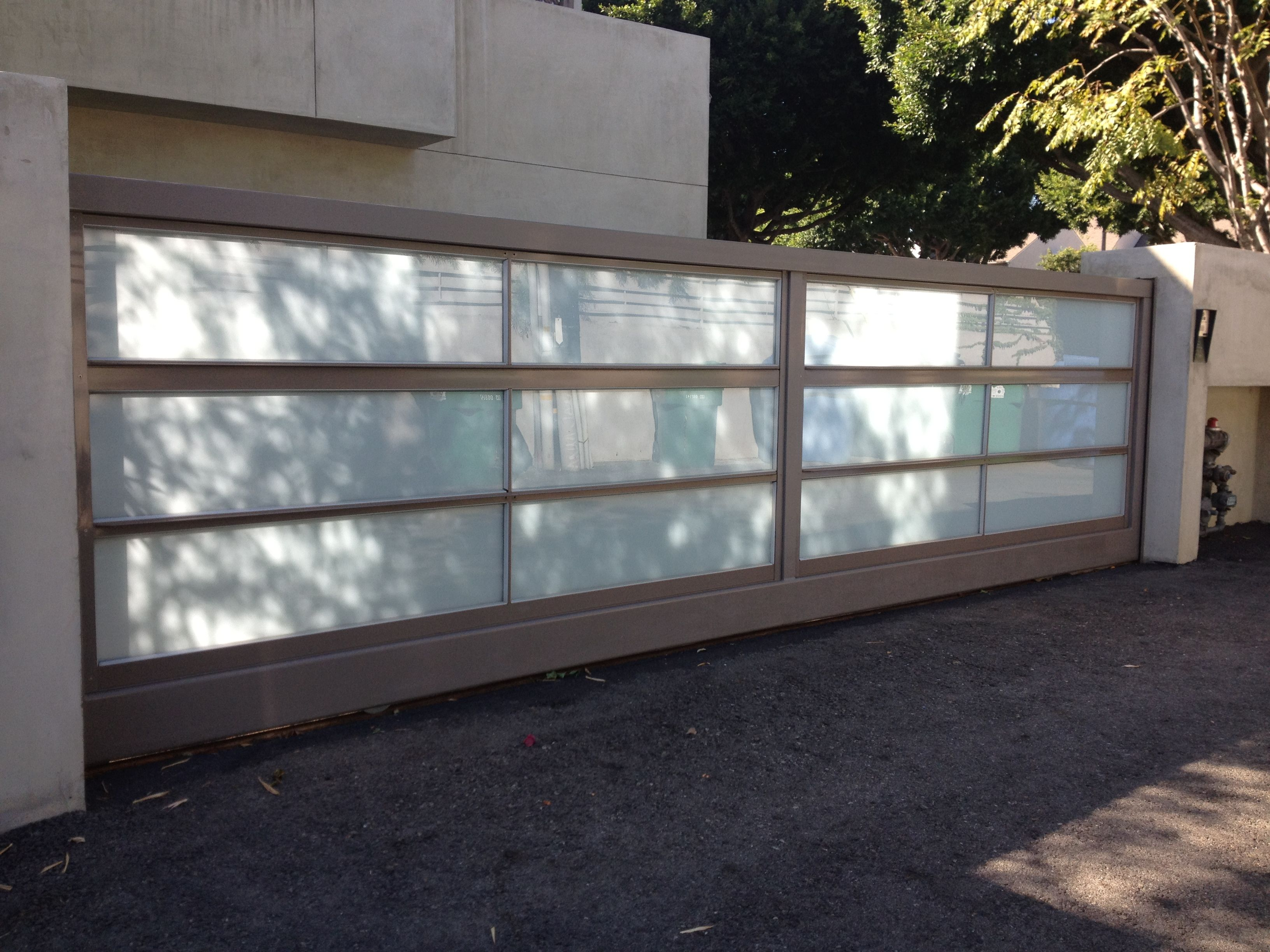 Sliding Gate For Garage Steel And Glass Sliding Gate Glass Gates And Garage Doors