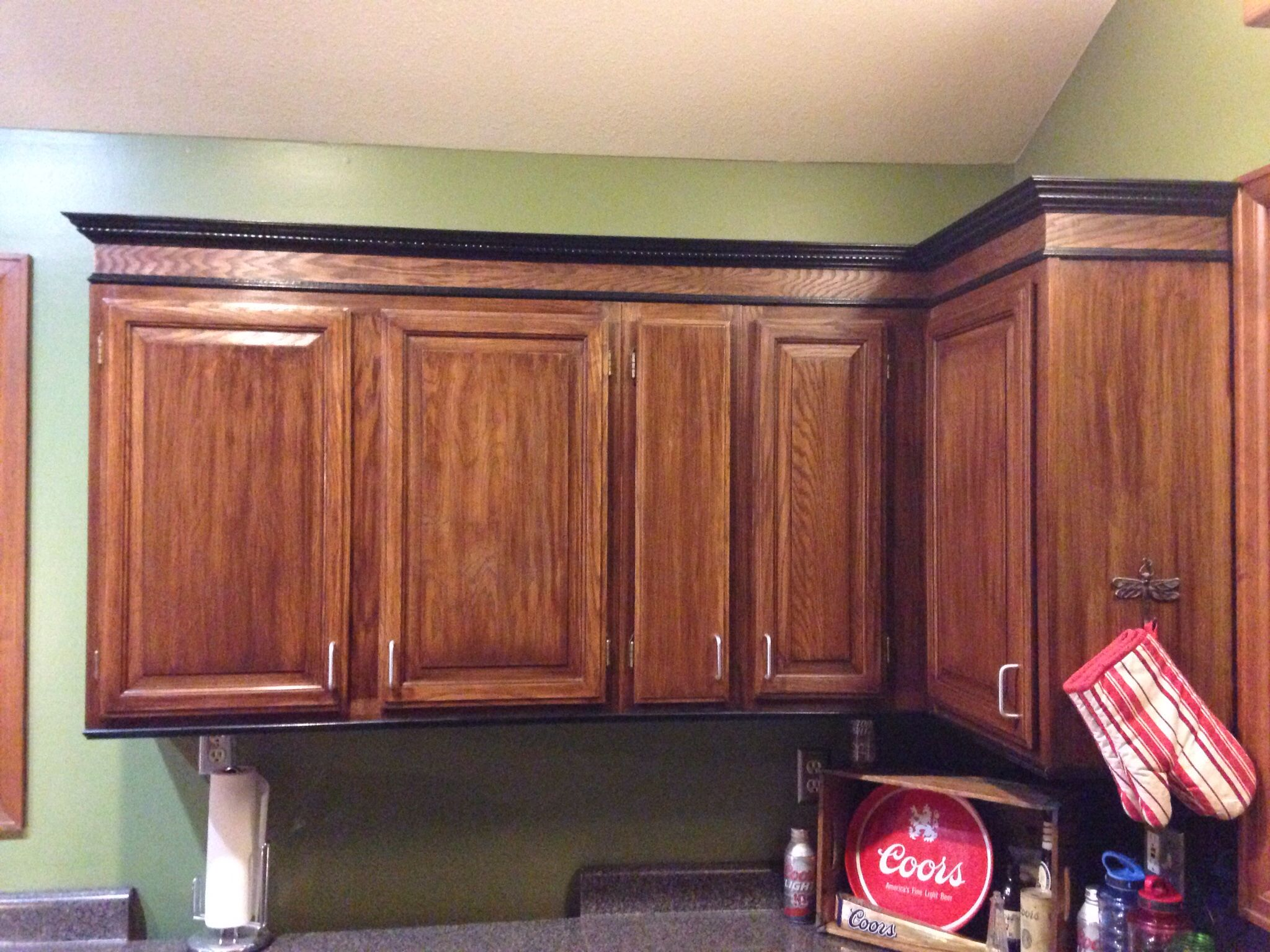 Just Stained The Honey Oak Cabinets Darker And Added Trim To The Top And Bottom Thanks To My Awesome Hub Honey Oak Cabinets Oak Cabinets Painting Oak Cabinets