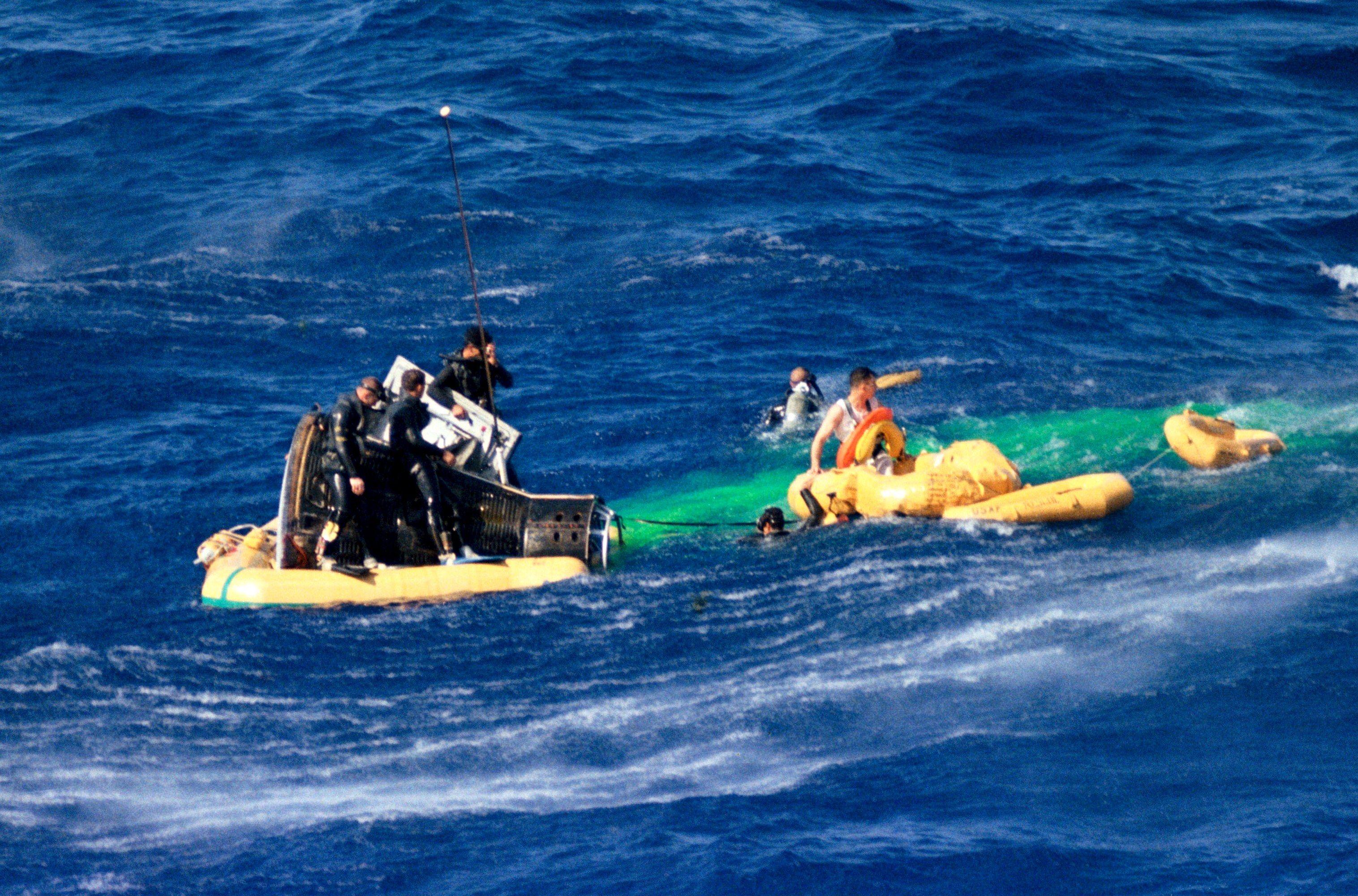 Gemini III pilot John Young waits in a life raft to be