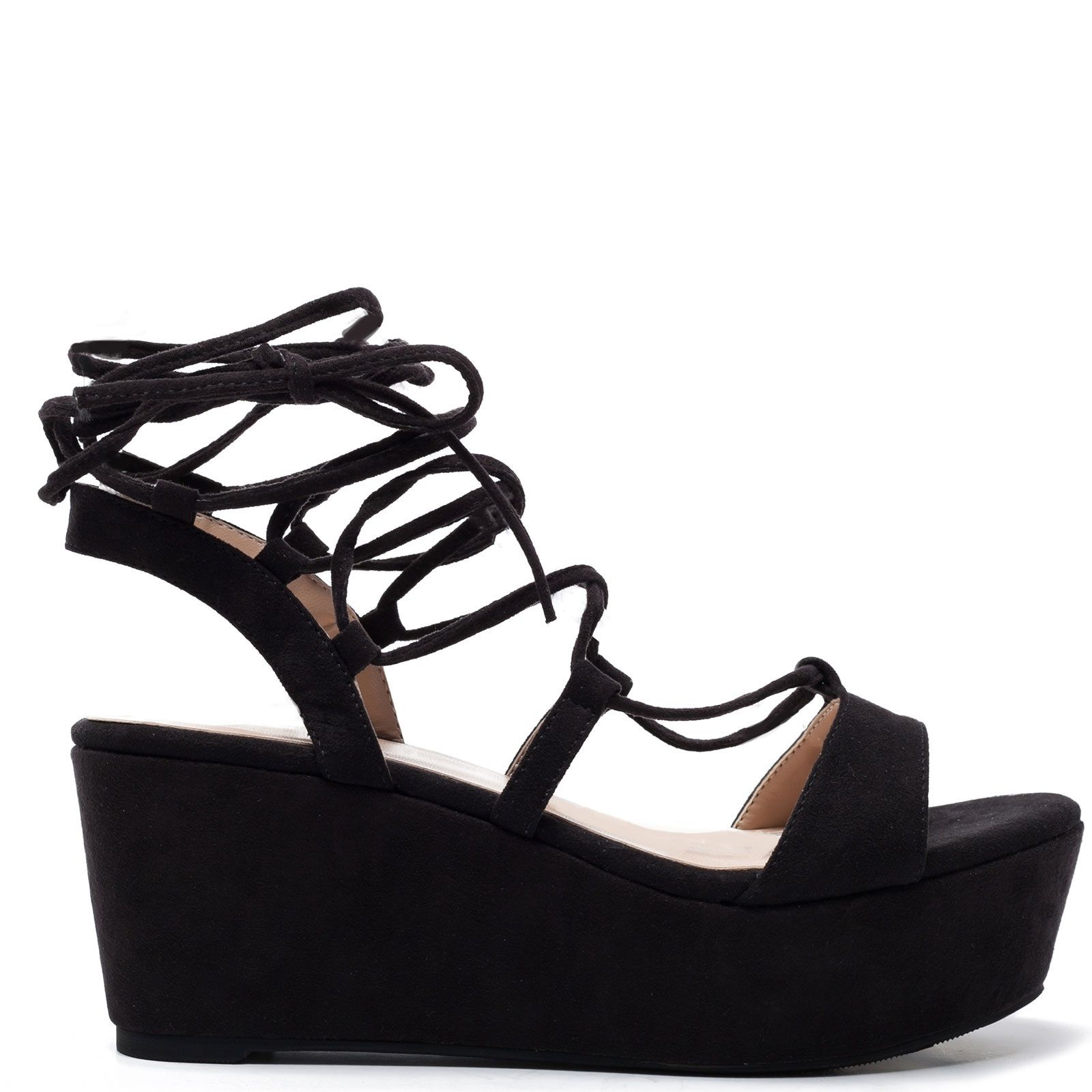 Black low platform with laces that tie on the ankle.