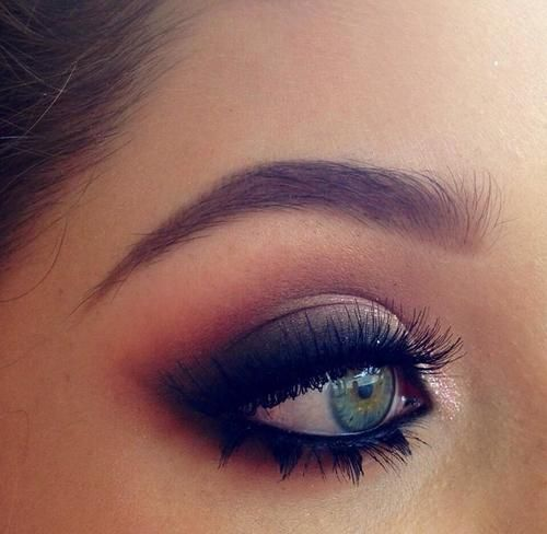 A pretty daytime smokey eye with top and bottom false lashes.