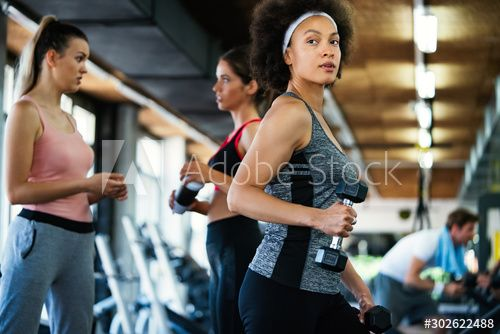 Fit sporty women exercising and training at fitness club , #AD, #women, #sporty, #Fit, #exercising, #club #Ad