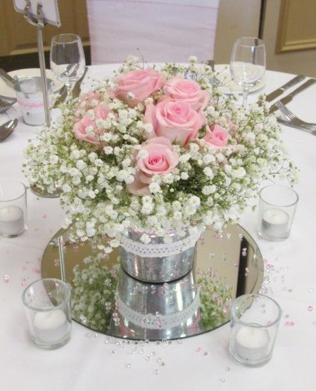 Zinc bucket table centrepiece with gypsophila and rose