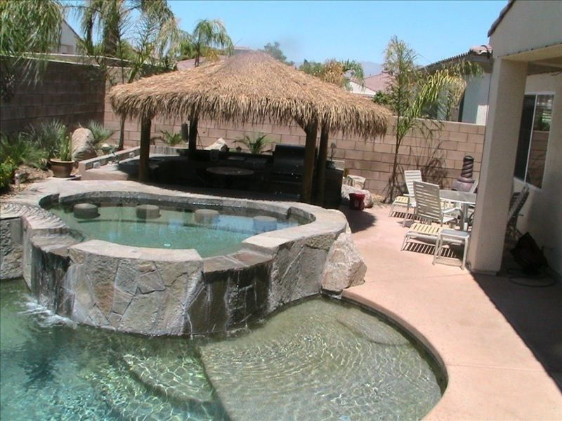 Swim Up Bar In Extra Large Spa With Complete Outdoor Kitchen Under A Huge Palapa Backyard Pool Hot Tub Pool Houses