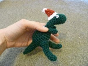 T-Rex - Free crochet dinosaur pattern with optional Santa hat by Jazmo Tennant. #crochetdinosaurpatterns