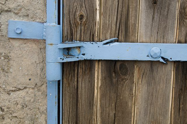 How To Hang A Gate On A Concrete Block Fence Hunker Cinder Block Walls Concrete Blocks Wood Fence Gates