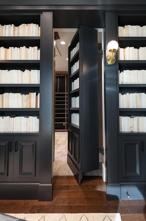 Alice Lane Home   Beautifully Designed Den Features Built In Black Bookcases  Fixed On Either Side Of A Hidden Bookcase Door Illuminated By A Cedar U0026  Moss ...
