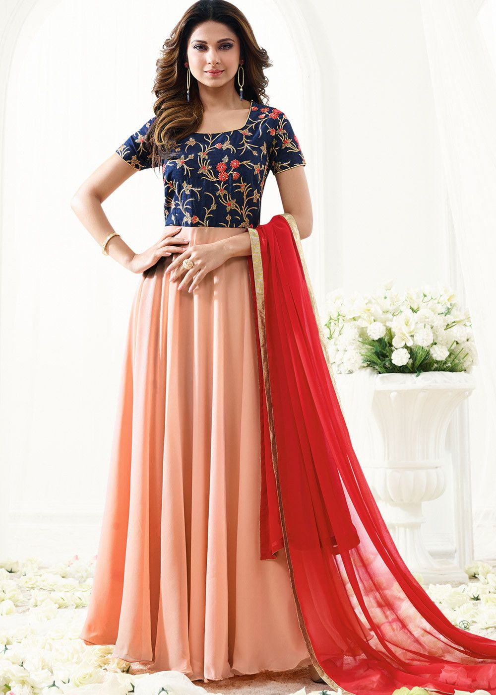 Look ravishing in this navy blue peach designer georgette and