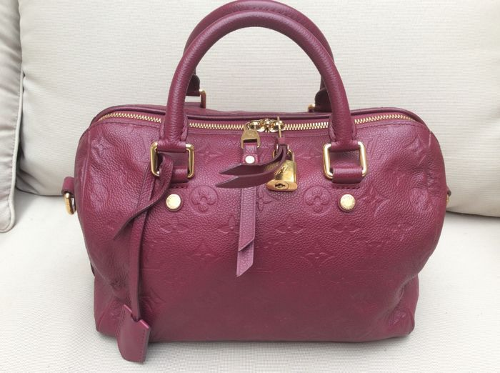 551f1ce4ac5c Louis Vuitton - Aurore Monogram Empreinte Leather Speedy Bandouliere 25 Bag  De speedy bandouliere 25 heeft