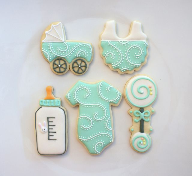 Beautiful baby shower cookies! Put in individual cellophane bags at each place setting.