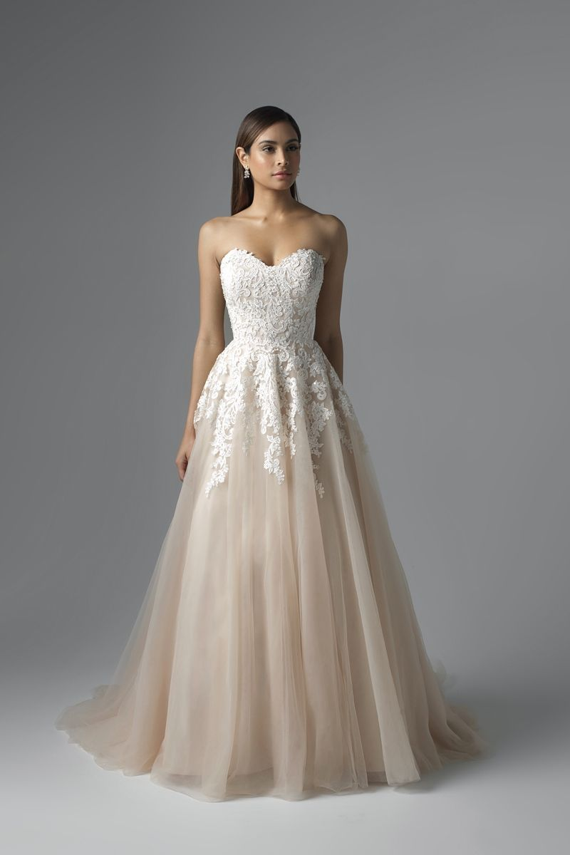 7a94f2d33af15 Exclusive Designer Wedding Dresses at unbeatable prices. Visit Luv Bridal  in Phoenix