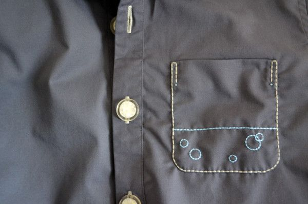 breast pocket detail of embroidered grey shirt dress by Minus Sun