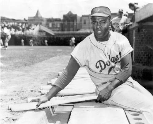 Brooklyn Dodgers' Jackie Robinson in the dugout at Wrigley Field on June 6,1954.