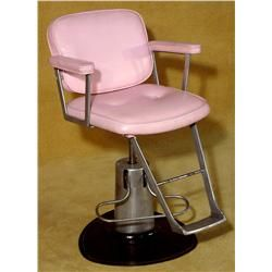 Vintage Pink beauty salon chair with pneumatic lift.