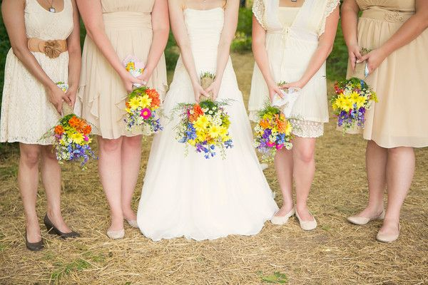 Neutral Bridesmaid Dresses And Bright Wildflowers Bridesmaid