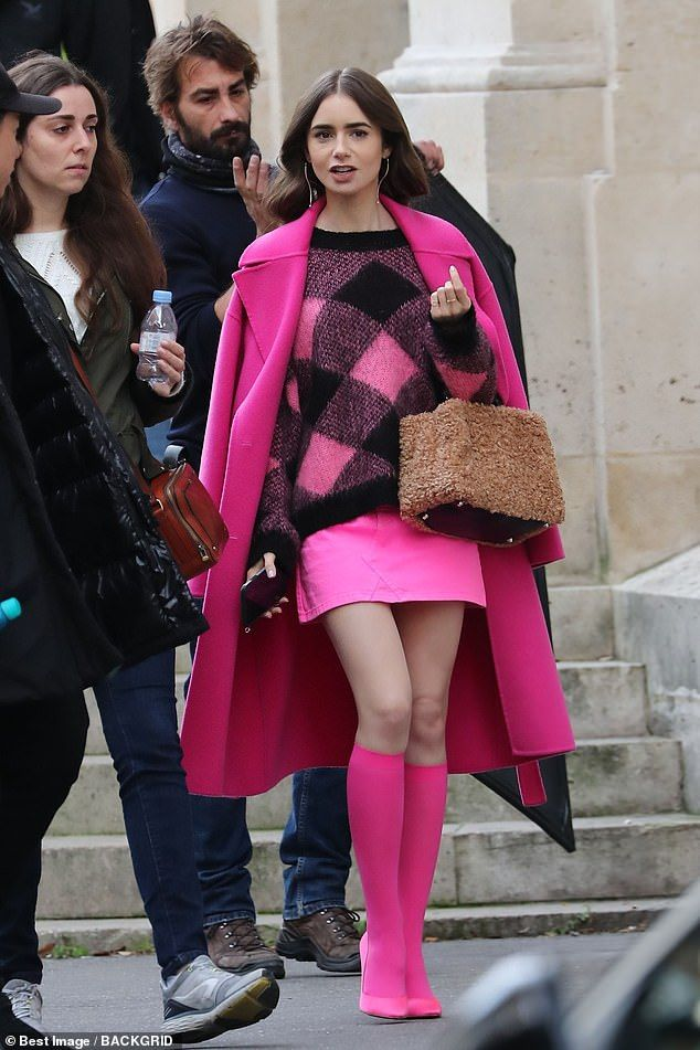 Lily Collins displays her endless legs as she shoo