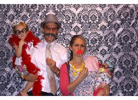 Easy photo booth....a backdrop and a bunch of props!