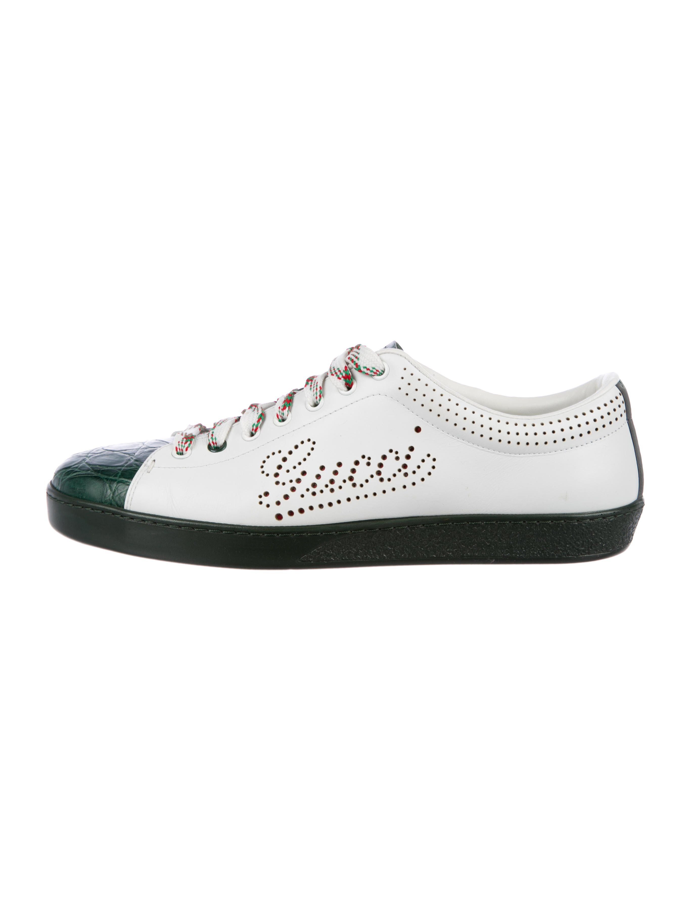 b6a80b738875 Men s white leather Gucci low-top sneakers with green crocodile trim ...