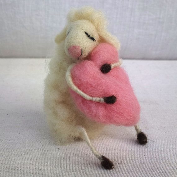 Needle felted dreaming sheep hugging light pink heart. This lovely sheep is made of 100% natural Bulgarian white and brown un-dyed wool. I used needle felting technique to create her. She is dreaming for love and care, for new home and to make someone happy. The sheep has wire in her hands