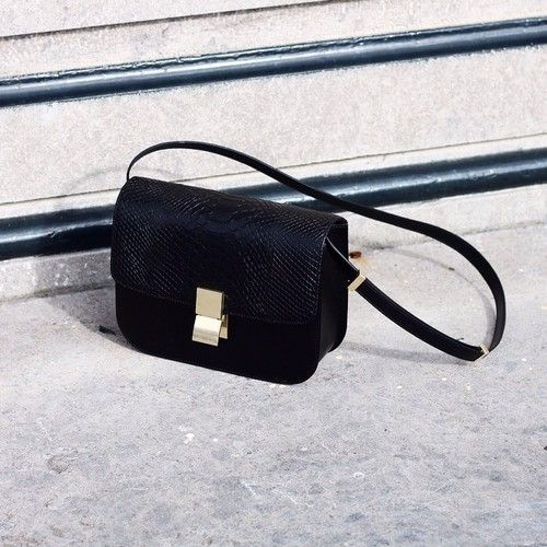 0e3b0e0676 Sleek and simple black shoulder bag with gold buckle. Perfect size and shape  for daytime or night.