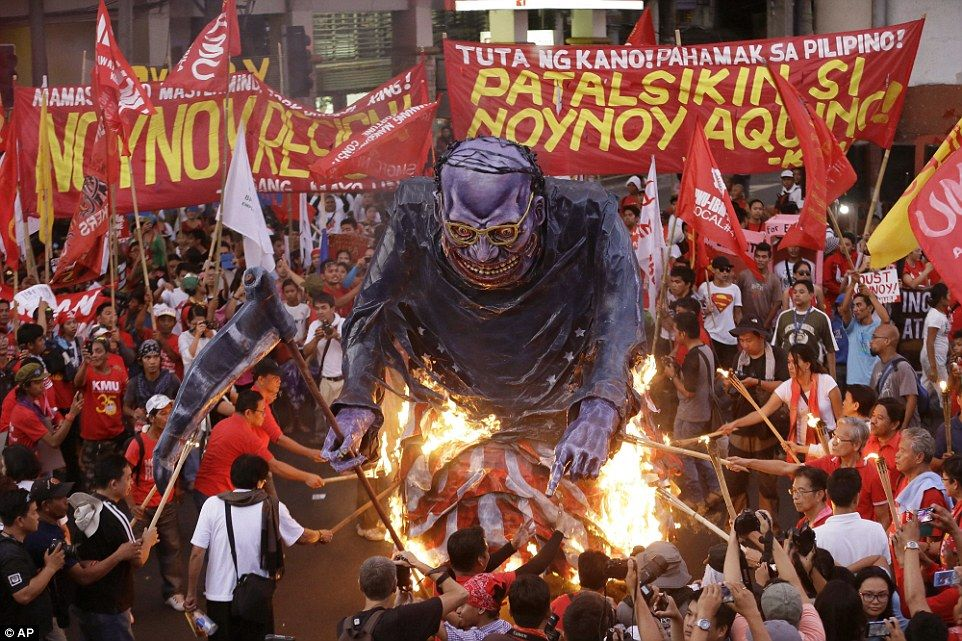 Violence: Activists in Manila burned a huge effigy of Philippine President Benigno Aquino ...