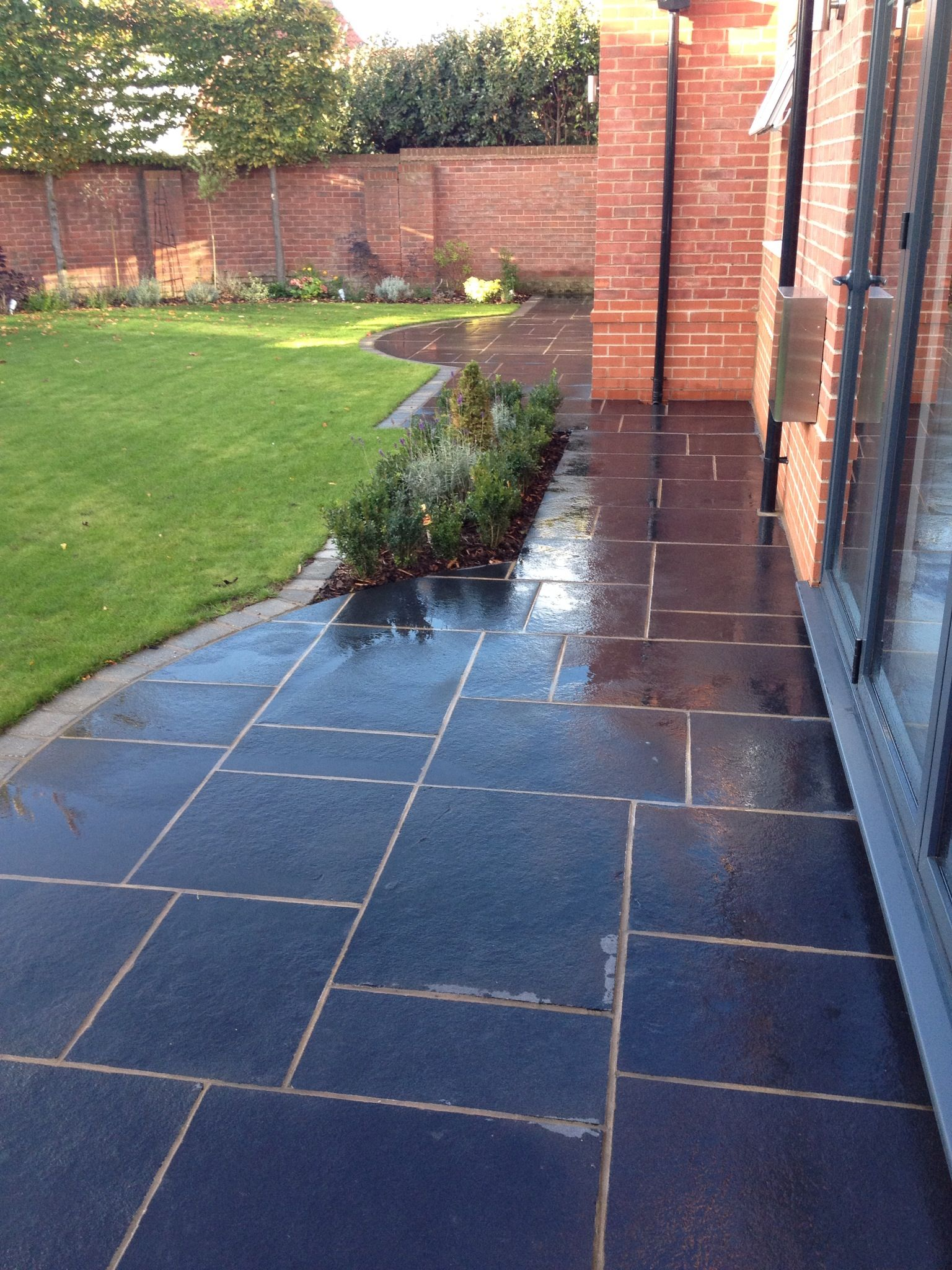 Midnight Black Limestone Paving outside a London terrace. The stone ...
