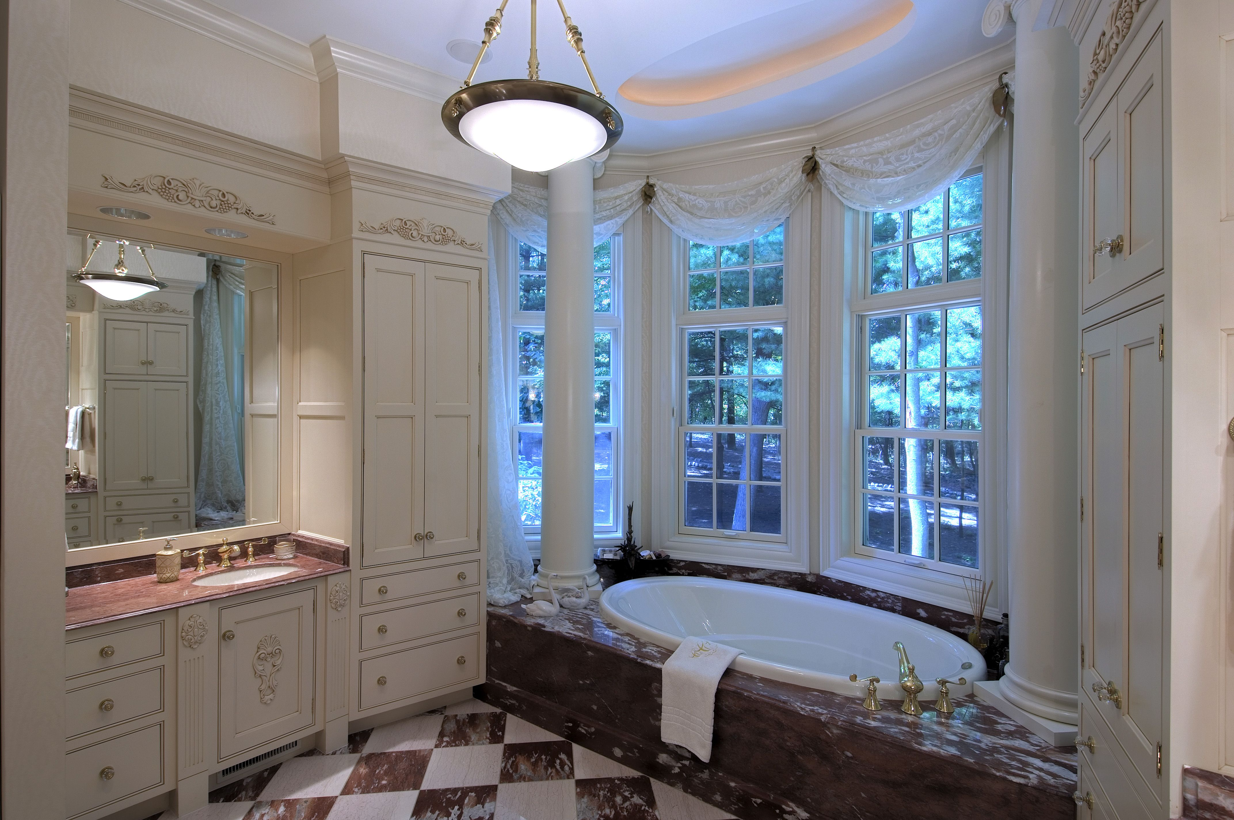 Marble tub deck with drop in bath tub and decorative columns ...