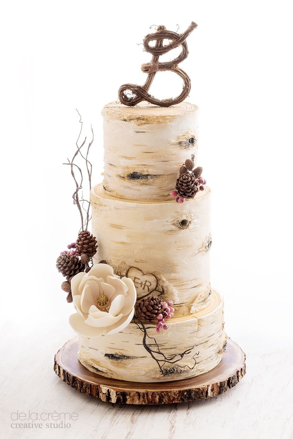 Birch tree and pine cones wedding cake by de la creme studio