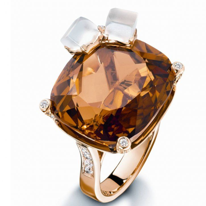 18K yellow gold ring set with 1 cushion-cut citrine , 2 carved quartz and 100 brilliant-cut diamonds by Piaget