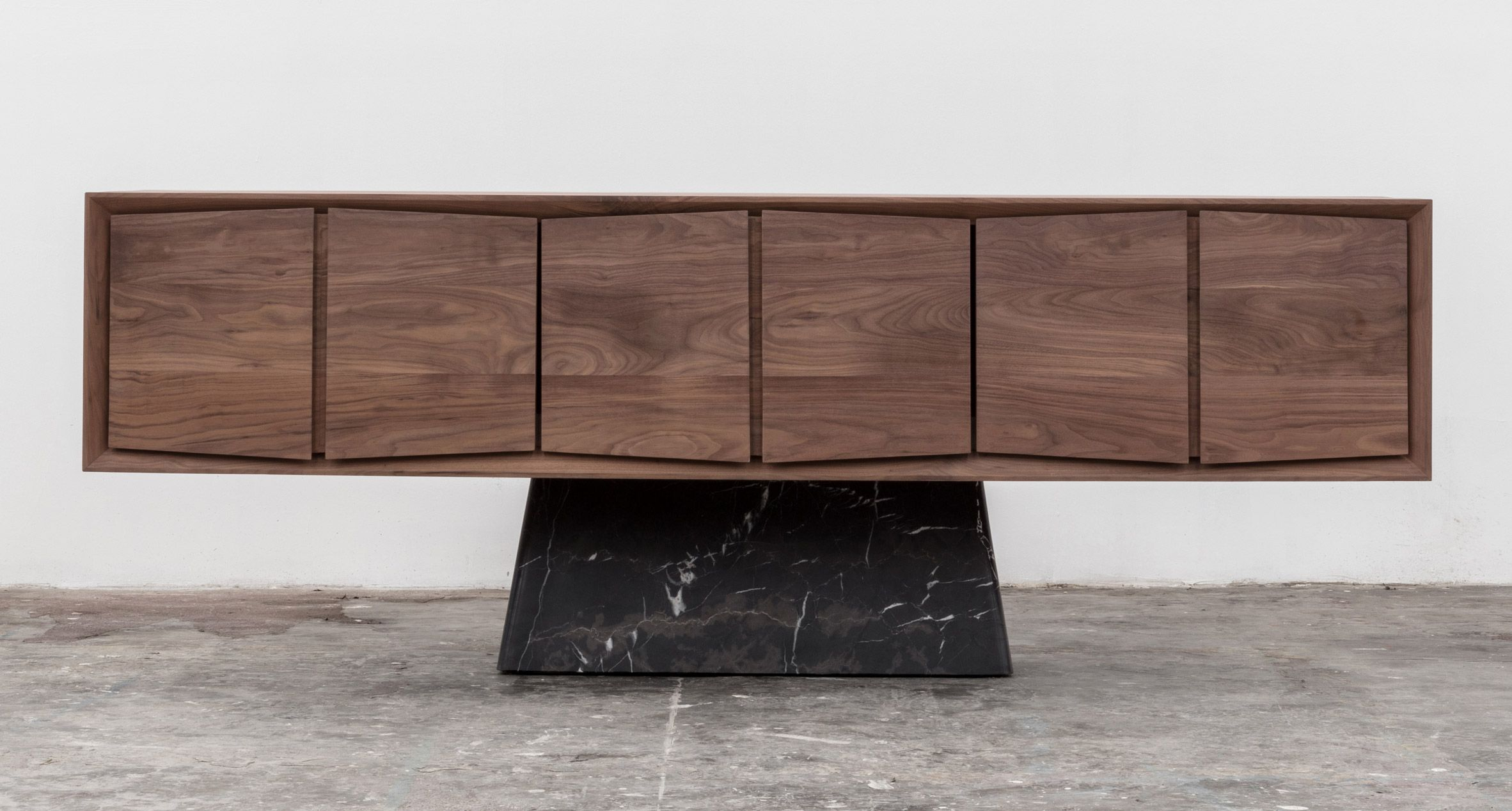Mexican Design Studio Esrawe Has Created A Long Wooden Cabinet That Balances On A Proportionally Small Marble Ba Brutalist Furniture Marble Furniture Furniture
