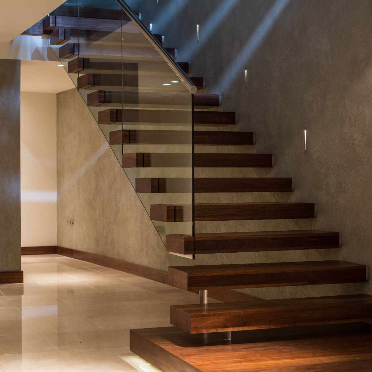 Floating staircase with glass for basement stairs with wine cellar  underneath