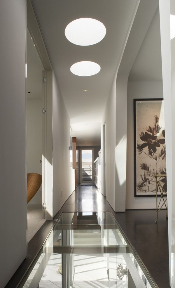 Sleek and creative mixed use townhouse by Dennis Gibbens Architects