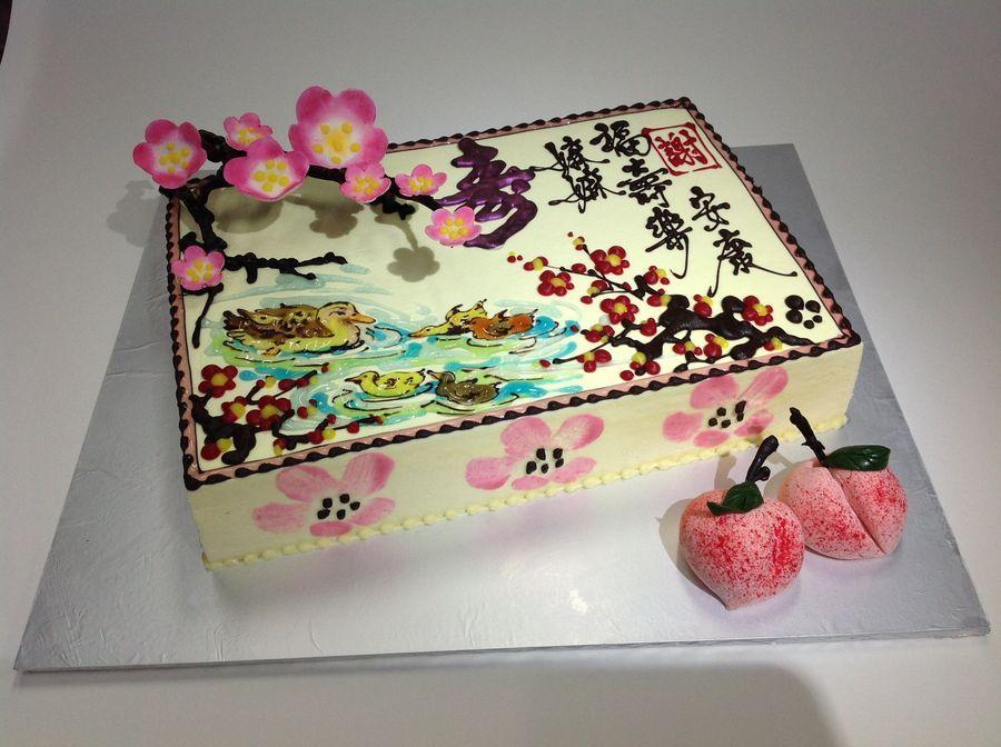 Oriental design birthday cake with 3D cherry blossom chocolate 3D