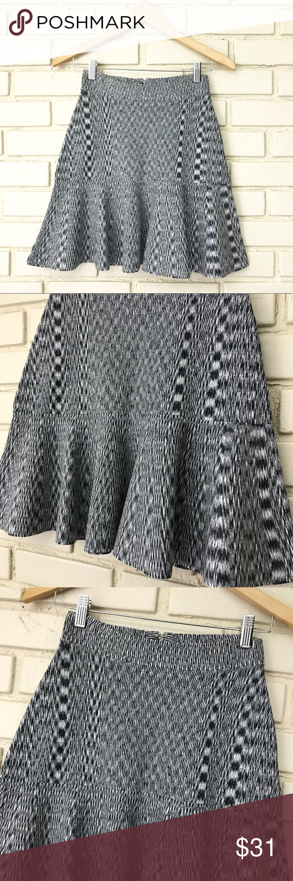 Guess - Stretchy fit and flare Ruffle skirt M Guess -  stretchy fit and flare skirt with Ruffle at the bottom. Please see photo of drawn diagram for approximate measurements. Back zipper enclosure and hook and eye. Great condition! Guess Skirts