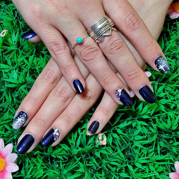 Dark purple polish with galaxy and bling feature nails! www ...