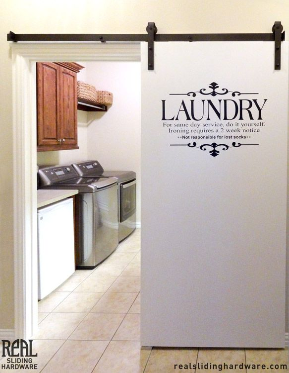 Sliding barn door laundry room the interior gallery for Laundry room door ideas