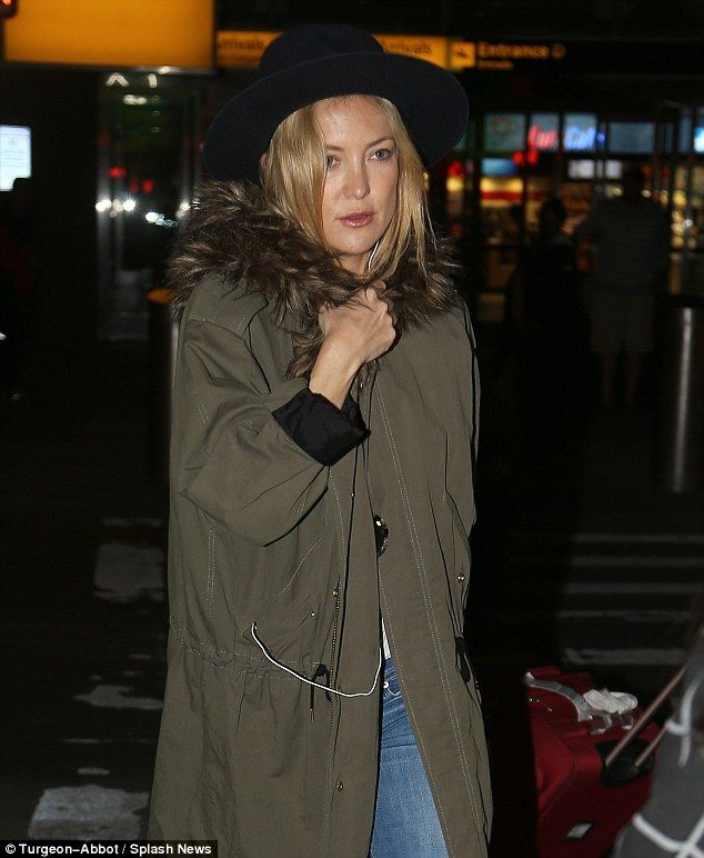 Cool blonde: Kate appeared to feel the chill as she exited the airport to take a ride into...