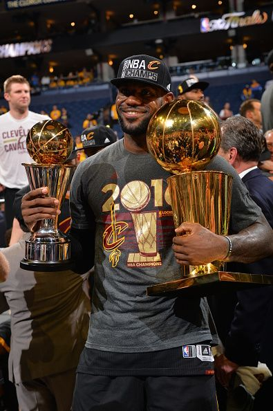 e807c857376 LeBron James of the Cleveland Cavaliers holds his MVP and Championship  Trophy after the game against the Golden State Warriors during the 2016 NBA.