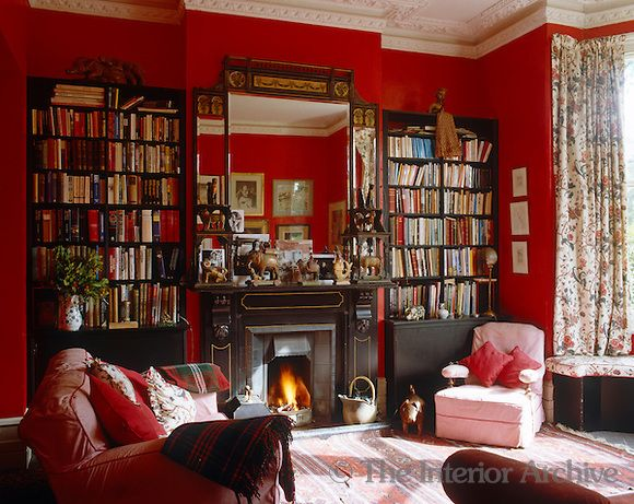 A Roaring Fire Burns In Victorian Fireplace This Red Painted Living Room Which