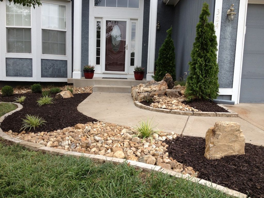New landscape with stone edging dry river creeks and a for Landscaping with rocks