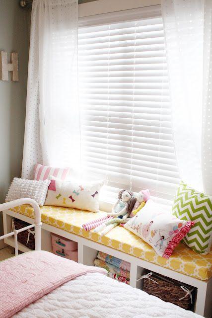 IKEA bookshelf turned window seat. LOVE for the girls' rooms!