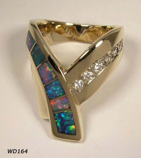 OH MY GOD basically the ring I fell in love with just different cuts now I can bring it to David and have him make it for me!!!!! Can anyone else hear graduation present?!?!?!?!