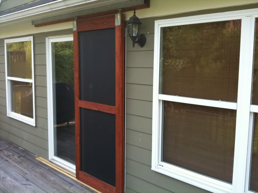 Built a sliding screen door the garage journal board for Entry door with built in screen