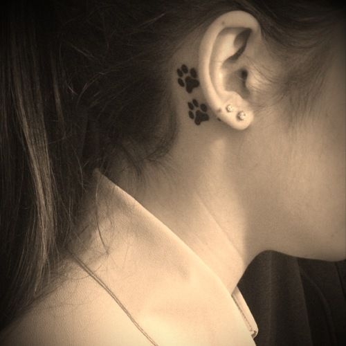 """My first tattoo, two dog paw prints behind my right ear ..."