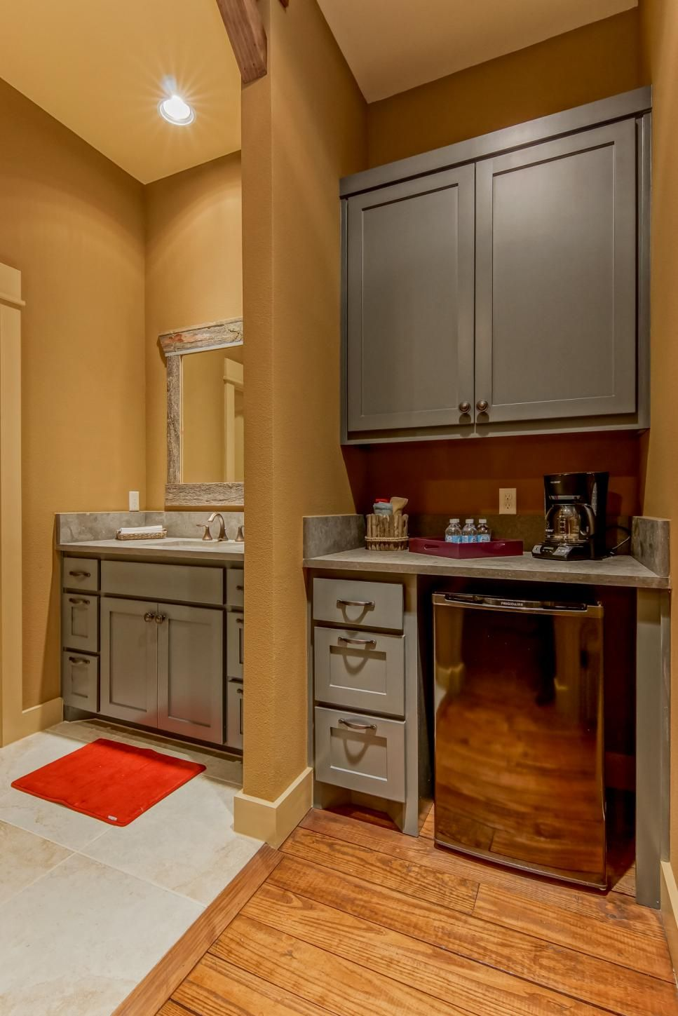 Country Wet Bar and Sink With Gray Cabinets and Mustard ...