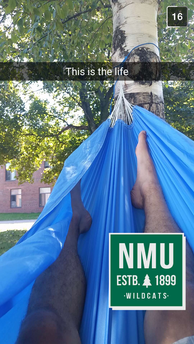 NMU student Cody Ochs is living the dream: enjoying the fabulous summer weather in a hammock outside the residence halls!
