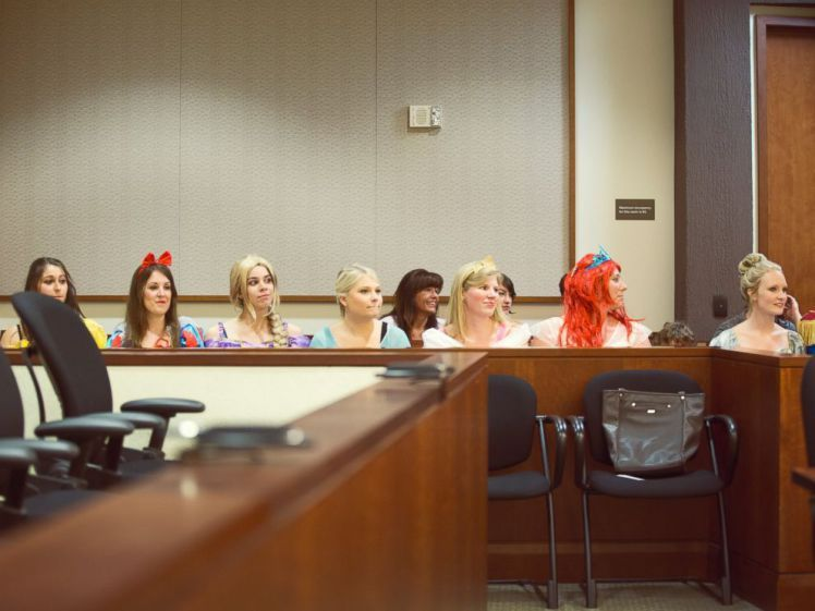 A load of Disney princesses turned up to this little girl's final adoption hearing