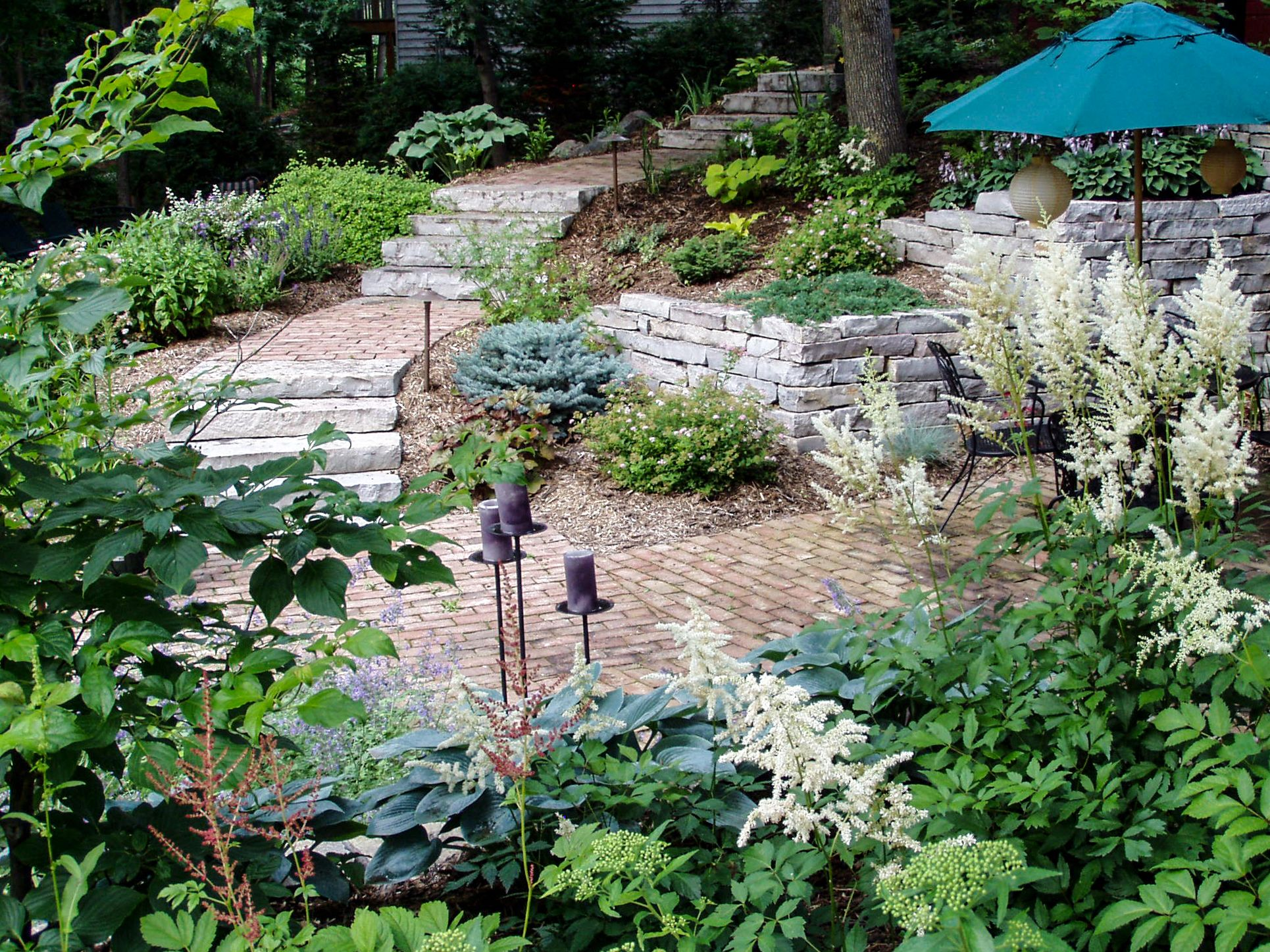 Stone And Pavers Combine To Make This Backyard A Work Of Landscape Design Art Landscape Design Landscape Projects Diy Landscaping